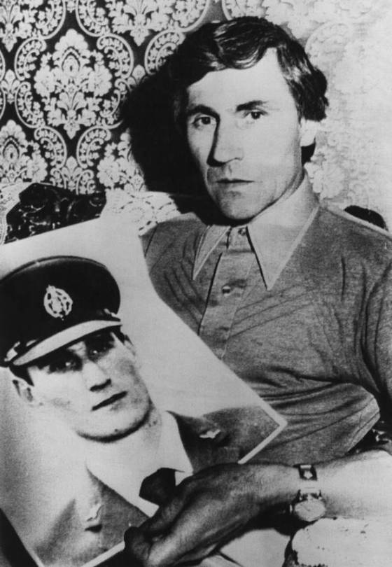 Guido Valentich holds a photograph of his son Frederick, a pilot who went missing while on a flight to King Island in a Cessna in October 1978. Photo / Getty