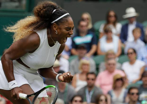 United States' Serena Williams celebrates after winning a point against United States' Alison Riske during a women's quarterfinal match on day eight of the Wimbledon Tennis Championships. Photo / AP.