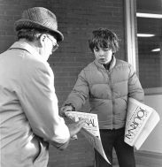 A Wednesday Journal carrier, and he looks a lot like a Delaney, hands out copies of an EXTRA edition at the Green Line el. Before digital publishing, we did EXTRA's when big news broke.