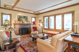 Intricate Prairie-style brickwork seen on the home's facade is repeated on the fireplace surround in the home's living room at 401 N. Cuyler Ave. The room also features the style's trademark long bands of oak trim.   Courtesy VHT Studios