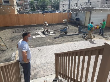 Patrick O'Brien shows off the back yard at Lathrop House Caf? %u2014 the yard will eventually have plenty of seating, bocce ball, BBQ pit and a bar suitable for a variety of private events.