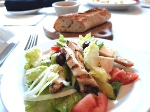 Lunch offerings at Donny G's: Greek salad with grilled chicken, feta, tomato, cucumber, and pepperoncini (half order pictured)