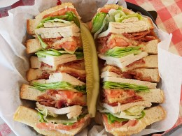"The Big Guys club sandwich features a half-pound of whole roasted turkey, bacon, lettuce, tomato, and mayo. As part of ""Tuesday Soup Days"" this bad boy comes with a free cup of soup."