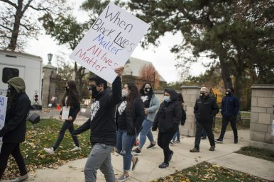 Some 40 Dominican University students leave the main campus on a Walk of Solidarity Oct. 29. The protest focused on issues of police violence against Black people and on issues of racial equity internal to the River Forest campus. | Alex Rogals/Staff Photographer