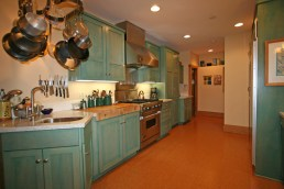 The kitchen includes Amish cabinets, cork floors, double work sinks and a professional Viking stove and hood.
