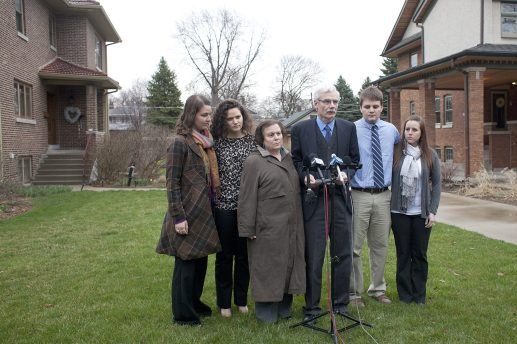 Tom Smedinghoff, center, reads a statement flanked by members of his family after a visit with Secretary of State John Kerry. His daughter, Anne Smedinghoff, was a diplomat with the state department when she was kiiled in Afghanistant April 6 while delivering books to a local school. David Pierini/Staff Photographer