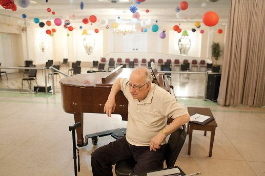 """Saxophone player and band leader Goerge Millonas pauses after a rehearsal for his orchestra's final concert. """"My lungs are OK,"""" he said. """"But my body is giving out."""""""