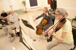 Liene Sorenson, right, Pat Parsons, Jm Scherer and Albert Hasselman practice with the rest of the Mills Orchestra at the Oak Park Arms on May 14.