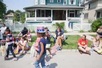Some were content with a curbside seat, while others, mostly children, chose to be mobile to collect candy.