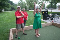 Cheryl Cargie, right, is elated after a teammate bowled. Charlie Thompson, left, and Dave Zyer stare in disbelief.