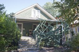 """Home Improvements: """"Expansion (Trespass),"""" by Robert Gero, occupies the front of Sabina Ott's house on South Highland Avenue. (DAVID PIERINI/Staff Photographer)"""