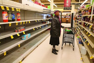 Shelf life: Jean Dillard searches for apple juice in the Dominick's grocery store on Lake Street in Oak Park. The store will close Dec. 28. (DAVID PIERINI/Staff Photographer)