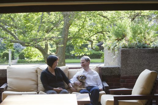 June 12: Carollina Song and Alec Harris, with their dog, Maisy, on the side porch of their home, the Beachy House, designed by Frank Lloyd Wright. The porch is a favorite spot for the family. DAVID PIERINI/Staff Photographer