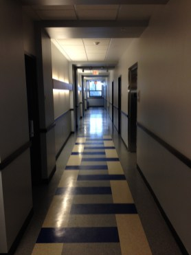The asymmetrically composed corridor with the window at the end is delightful.