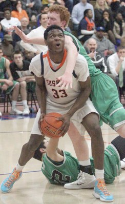 OPRF center Javonni Harrell gathers to up for a shot against 6-foot-8-inch York center Frank Toohey.Harrell contained the highly-touted Toohey, who will play basketball at the Air Force Academy next season. (Photo by Vic Guarino)