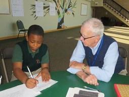 Bill Higgins tutors scholars at Catalyst School. (Courtesy Lynne and Bill Higgins)