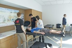 Volunteers from Young Hearts for Life perform an electrocardiogram on OPRF Hockey Club player Liam Burns at Ridgeland Common (Courtesy Brian Cassidy)