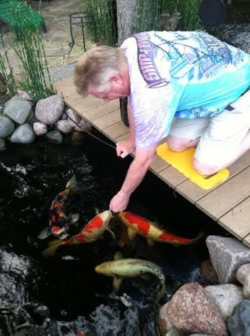 Gardenscape: Riverside resident Ed Buck built an elaborate Japanese pond in his backyard, complete with colorful koi fish. | Photo courtesy of Ed Buck