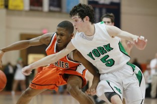 Oak Park and River Forest lost to York, 67-52, in the semifinal of the Class 4A Oak Park Regional at OPRF, Tuesday, March 1, 2011. Photo by J.Geil.