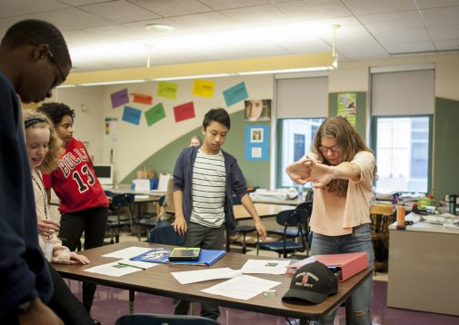 Pooja Nagpal from NAMI has students Gwendolyn Brooks Middle School stretch before telling her story about the mental illness she struggles with everyday. | WILLIAM CAMARGO/Staff Photographer