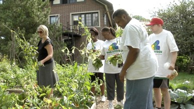 Cheryl Munoz (left) and volunteers gather in the garden at Cheney Mansion in Oak Park. | Photo provided