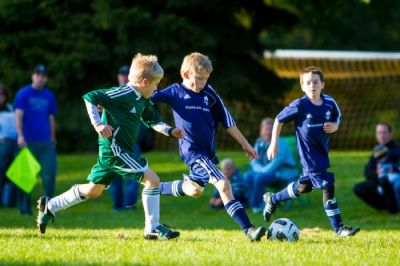 Several Chicago Edge Soccer Club players have fun while competing in a match. (Courtesy Chicago Edge Soccer Club)