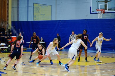 Maeve Nelson, center with ball, is an excellent defender and capable scorer on the OPRF basketball team.   File photo