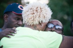Sharita Galloway, the mother of Sims, receives a hug at the Aug. 31 vigil, held in memory of her late son, Elijah. | William Camargo/Staff