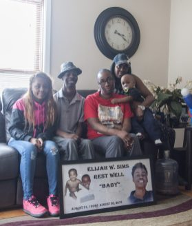 The loved ones of Elijah Sims keep his memory alive by reflecting on his outgoing personality. From left to right: Tayanna Norman, Isaiah Sims, Sharita Galloway, Shawanda Bell and King Sims.   WILLIAM CAMARGO/Staff Photographer