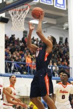 OPRF senior Malachi Ross is an underrated leader for the Huskies. He is an outstanding defender and rebounder, and also a capable scorer and playmaker offensively. (Photo by Vic Guarino)