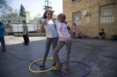 Participants in the Y-kids program catch up with each other after school during arrival activities.