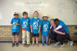 Hannah Nelson, camp counselor and Y-Kids lead teacher with a group of boys.