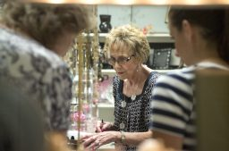 Penny Egerter, 84, prices jewelry in the Gift Room, run by Infant Welfare Society volunteers. | ALEXA ROGALS/Staff Photographer