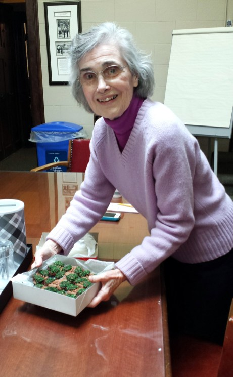 Louise Varnes, who eventually became a paid employee, brings homemade cookies to the staff. | Provided