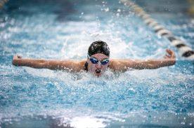 Fenwick junior Katie Drumm competes in the 100-yard butterfly. (Alexa Rogals/Staff Photographer)