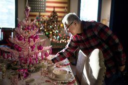 Jerry Ehrenberger fixes up a pink Christmas tree displayed on a table upstairs on Nov. 14, at the Oak Park River Forest Museum on Lake Street in Oak Park. | Alexa Rogals/Staff Photographer