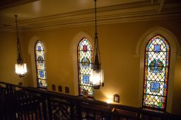 SisterHouse provides contemplative spaces, like this former chapel space, with its stained-glass windows (above). | Alexa Rogals/Staff Photographer