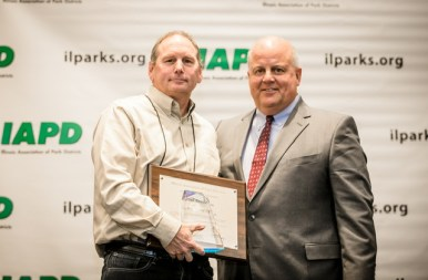 Paul Aeschleman with 2018 IAPD Chairman, John Hoscheit, receiving his award at the IAPD Annual Business Meeting. | Provided photo