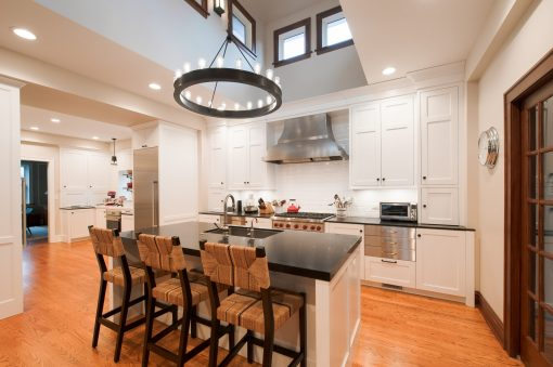 """Food blogger Emily Paster had designer Mark Menna create a """"two-in-one"""" kitchen that includes a separate working kitchen (seen in the background above, at left) for her to test recipes in addition to a family-centered kitchen (above) in her River Forest home. (Mark Wright Photography)"""