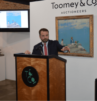 """Going once, going twice ... : Vice President/Senior Specialist John Walcher seeks bid for the painting """"Three Women on Hilltop,"""" an oil on canvas painted by Charles Courtney Curran, during the Toomey & Co. Art & Design Auction on June 9. The painting was donated to the Economy Shop and the bulk of the proceeds from the painting's auction will benefit six local charities.   Photo provided"""