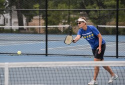Karen McMillin keeps her eye on the ball during a pickleball match. The Oak Park resident has been active in promoting the sport locally. (Alexa Rogals/Staff Photographer)