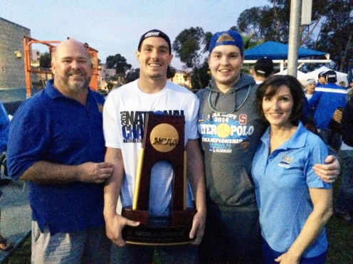 (L to R): Jim Farmer, Matt Farmer, Danny Farmer and Beatrice Farmer with the 2014 NCAA Mens's National Championship trophy won by UCLA. Matt, who starred at Fenwick High School, played for the Bruins and is currently on Team USA. (Submitted Photo)