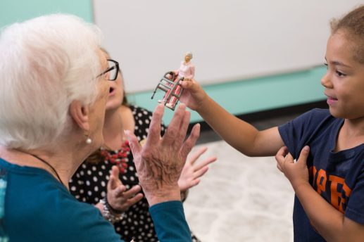 SHOW AND TELL: Livia Hill shows Shirley Mungi a doll she thinks looks like her at Kindness Creators Intergenerational Program on opening day, Aug. 29. Kindness Creators is a preschool located inside Oak Park Arms. | Courtesy Kindness Creators