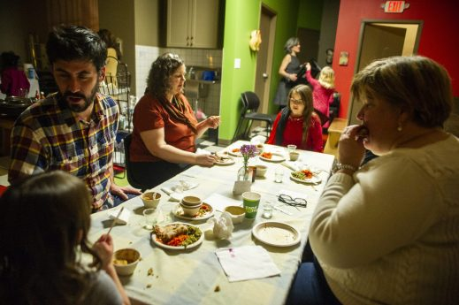 Guests try out the different foods served by the children on Jan. 24, during a Seed Cafe Night at the Seed Montessori on Madison Street in Oak Park. | ALEX ROGALS/Staff Photographer