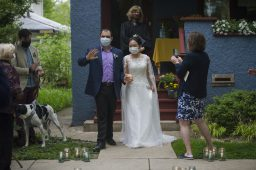 Daniel and Grace thank guests for joining on Monday, May 18, 2020, during an outdoor wedding on Carpenter in Oak Park, Ill. | ALEX ROGALS/Staff Photographer