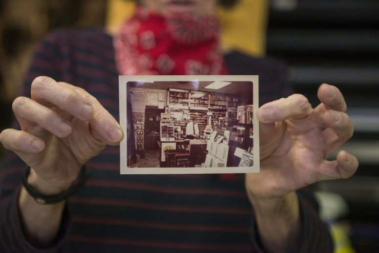 Deborah Pieritz holds up an old photo of her father inside the store on Friday, May 22, 2020, at Pieritz Brothers on Ridgeland Avenue in Oak Park, Ill. | ALEX ROGALS/Staff Photographer