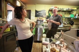 Long hours over a hot stove: Patrick and Olya Dailey, owners of Eastgate Cafe in Oak Park, clean up in the kitchen. Bottom left, the entrance on Harrison Street, just west of Lyman.