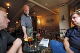 Multifaceted: Patrick Dailey serves customers at Eastgate Caf?.