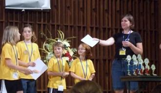 Julie Norton hands out certificates to Bible Bee participants. Photos by Matt Baron.