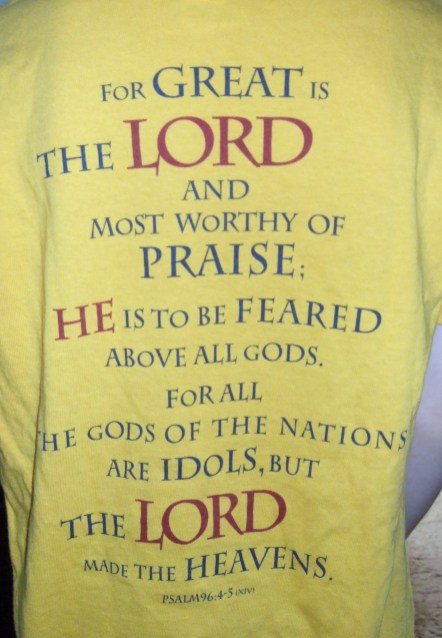 One of the contestants models the back of a Bible Bee shirt, complete with two verses from Psalm 96.